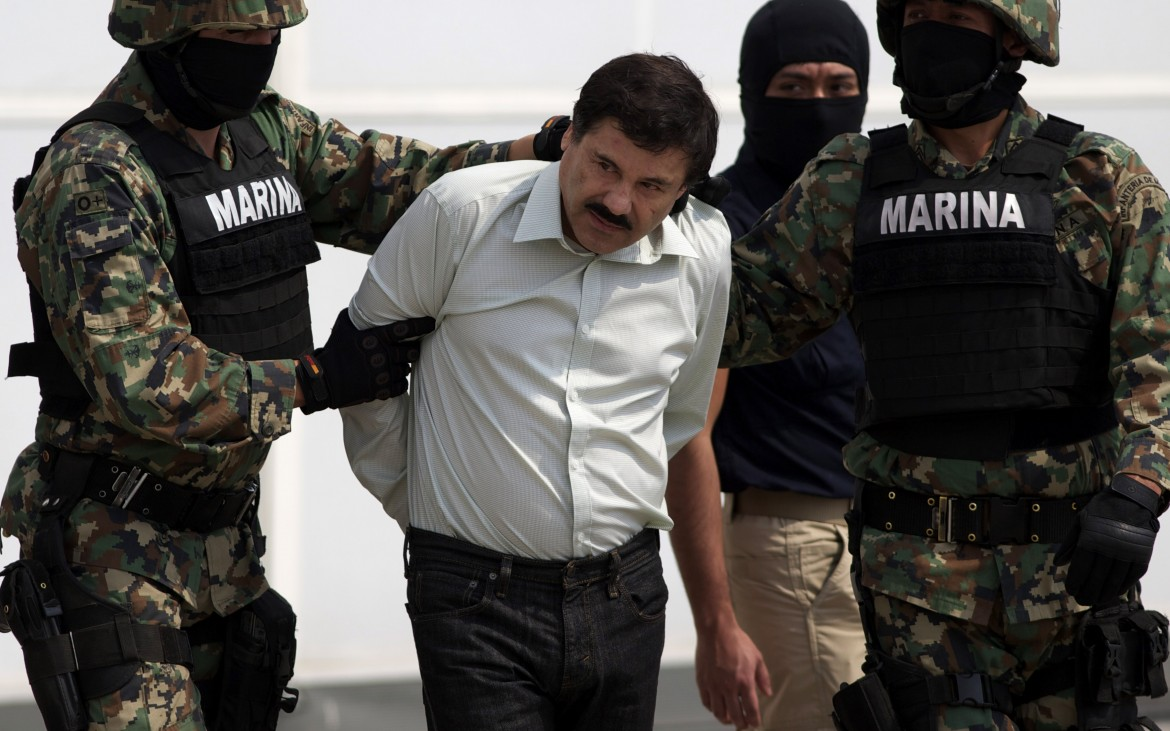 "Joaquin ""El Chapo"" Guzman is escorted to a helicopter in handcuffs by Mexican navy marines at a navy hanger in Mexico City, Mexico, Saturday, Feb. 22, 2014. A senior U.S. law enforcement official said Saturday, that Guzman, the head of Mexico's Sinaloa Cartel, was captured alive overnight in the beach resort town of Mazatlan. Guzman faces multiple federal drug trafficking indictments in the U.S. and is on the Drug Enforcement Administration's most-wanted list.  (AP Photo/Eduardo Verdugo)"